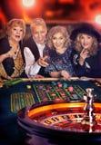 Senior people playing in casino stock image
