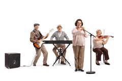 Senior people playing on guitar, violin and keyboard in a musical band stock photos