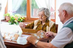 Senior people playing rummy Stock Photos
