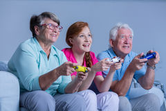 Senior people playing video games Royalty Free Stock Image