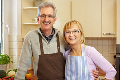 Senior people portrait in kitchen Royalty Free Stock Photo