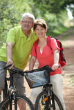 Senior people riding bicycle Stock Photography