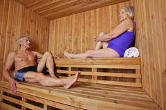 Senior people sitting sweating in sauna Royalty Free Stock Photo