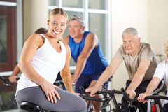 Senior people in spinning class in gym Stock Photo