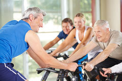 Senior people in spinning class Stock Photo
