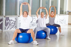 Senior people stretching in gym Stock Image