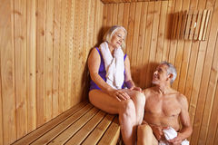 Senior people sweating in sauna. Of hotel in their holidays Royalty Free Stock Image