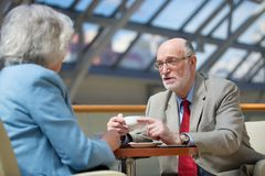 Senior couple drink coffee royalty free stock photo
