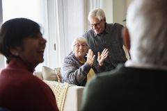 Senior people talking in a living room royalty free stock photography