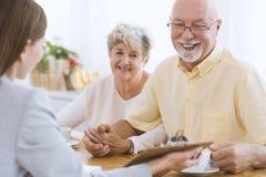 Senior people and financial advisor. Senior people talking to a financial advisor about life insurance Royalty Free Stock Photo