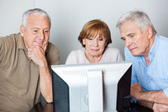 Senior People Using Computer In Classroom Royalty Free Stock Photography