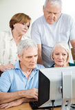 Senior People Using Computer Together In Class Stock Photography