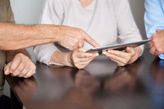 Senior People Using Tablet PC In Computer Class Stock Photos