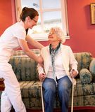 Senior people with walking crutches. Having assistance of a loving nurse stock photo