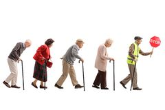 Senior people walking in a line behind an elderly man with a saf royalty free stock images