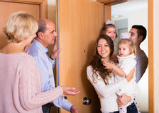 Senior people welcoming dear guests Royalty Free Stock Photo