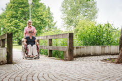 Senior People In Wheelchair stock images