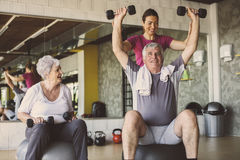 Senior people workout in rehabilitation center. Senior people with personal fitness trainer Stock Images