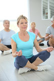 Senior people during yoga course Royalty Free Stock Photos