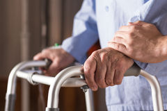 Senior person holding walking zimmer Royalty Free Stock Images