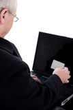 Senior person looking into his swipe card Royalty Free Stock Image