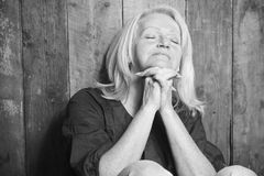 Senior person pray with a wood background. A senior person pray with a wood background Stock Photos
