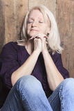 Senior person pray with a wood background Stock Images