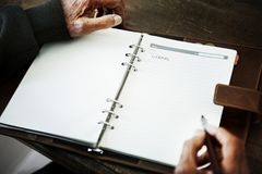 Senior person`s hand writing a journal Royalty Free Stock Photos