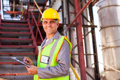 Senior petrochemical worker. Smiling senior petrochemical worker in plant Stock Photography