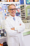 Senior pharmacist with arms crossed. In the pharmacy Royalty Free Stock Photography
