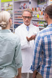 Senior pharmacist explaining the pills to patient Royalty Free Stock Photos