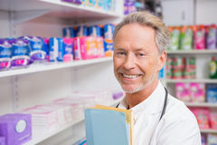 Senior pharmacist holding documents Stock Photos