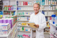 Senior pharmacist holding documents Royalty Free Stock Photography