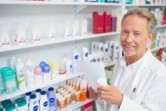Senior pharmacist holding a prescription Royalty Free Stock Photo