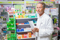 Senior pharmacist holding a prescription Stock Photography