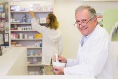 Senior pharmacist mixing a medicine Royalty Free Stock Photo