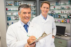 Senior pharmacist smiling at camera Royalty Free Stock Photo