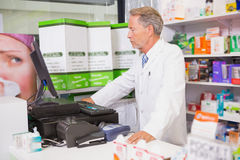 Senior pharmacist using the computer Royalty Free Stock Photos