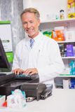 Senior pharmacist using the computer Royalty Free Stock Images