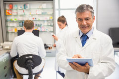 Senior pharmacist using tablet pc Stock Image