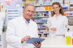 Senior pharmacist using tablet pc. At the hospital pharmacy Stock Photo