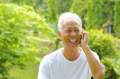 Senior on the phone royalty free stock image