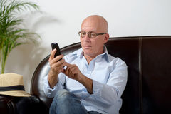 A senior phone Royalty Free Stock Image