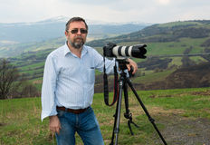 Senior photographer with camera Royalty Free Stock Images