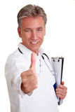 Senior physician holding thumbs up royalty free stock image
