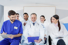 Senior physician making medical explanation for colleagues royalty free stock photography