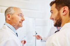 Senior physician trains student. And discusses with him Royalty Free Stock Images