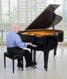 Senior pianist royalty free stock photo
