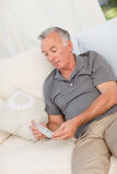 Senior with pills at home Royalty Free Stock Photos
