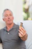 Senior with pills at home Royalty Free Stock Image